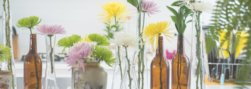 a gentle healing home - decorating for the senses - cut flowers in vases and jars